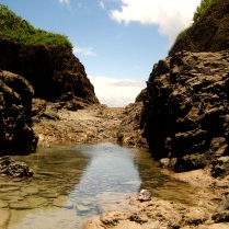 TIDAL POOL BETWEEN CLIFFS