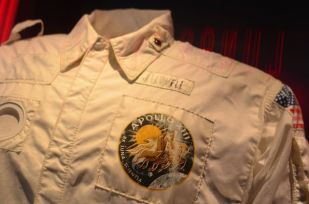 "ACTUAL SUIT FROM THE APOLLO 13 MISSION, DEEMED A ""SUCCESSFUL FAILURE."""